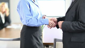 Handshake with business people in office stock video footage