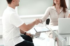 Handshake business people sitting at the office Desk stock image