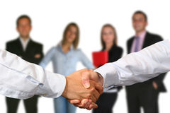 HANDSHAKE AND BUSINESS TEAM Royalty Free Stock Photo