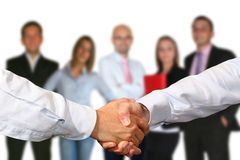 HANDSHAKE AND BUSINESS TEAM Royalty Free Stock Image