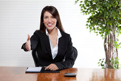 Handshake Business Woman. An attractive woman in a business suit extends her hand for a friendly handshake Royalty Free Stock Photos