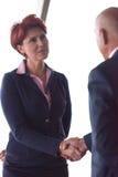Handshake of business woman and man Stock Photo
