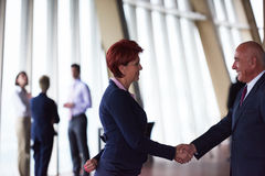 Handshake of business woman and man Stock Photo