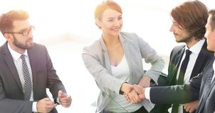 Handshake business women with business partner royalty free stock photography