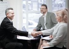 Handshake of a businessman and business woman at a meeting royalty free stock photos