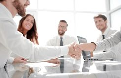 Handshake of a businessman and business woman over a Desk royalty free stock photography