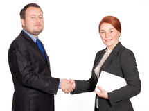 Handshake between businessman and businesswoman Stock Image