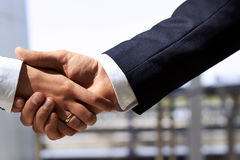 handshake  between businessman and businesswoman Royalty Free Stock Images