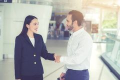 Handshake of businessman and businesswoman of business meeting, Royalty Free Stock Images