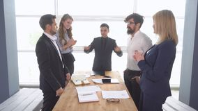 Handshake of businessman at the conclusion of the transaction. business meeting. Successful negotiations of a group of. Young businessman in the office of the stock video