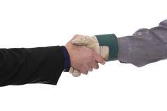 Handshake. Businessman and craftsman shake hands Stock Images