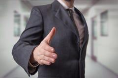 Handshake. Businessman offering for handshake on office buildings Stock Photography