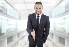 Handshake. Businessman offering to shake the hand at the office Royalty Free Stock Photo