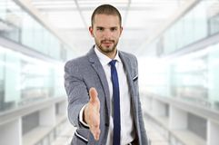Handshake. Businessman in suit offering to shake the hand at the office Royalty Free Stock Photography