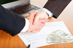 Handshake of businessmen after Stock Photos