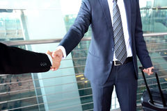 Handshake of businessmen at the airport - business travel concept Stock Photos