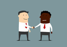 Handshake of businessmen from different countires Royalty Free Stock Photo