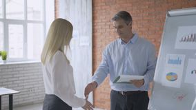 Handshake. businessmen are discussing the idea in the office. development of a working concept. 4K stock video footage
