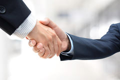 Handshake of businessmen Stock Images