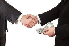 Handshake businessmen with money in hand Stock Image