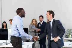 Handshake, Businessmen Shaking Hands During Meeting, Agreement In Front Of Business People Discussion Of Contract In. Office, Two Leaders Over Businesspeople stock image