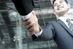 Handshake of businessmen with smiling face Royalty Free Stock Images
