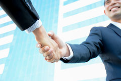 Handshake of businessmen with smiling face. Greeting , dealing & partnership concepts royalty free stock images