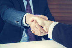 Handshake of businessmen in vintage tone. Greeting , dealing, merger and acquisition concepts Royalty Free Stock Photos