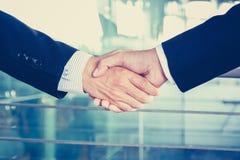 Handshake of businessmen, vintage tone Royalty Free Stock Photography