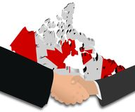 Handshake with Canada map flag Royalty Free Stock Photography