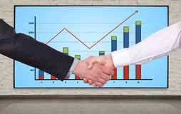 Handshake and  chart Stock Photography