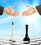 Handshake after the chess game. Concept of equal forces Stock Images
