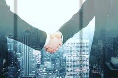 Handshake on city background Stock Images