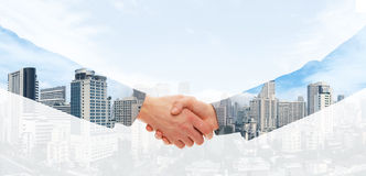 Handshake on a city background Royalty Free Stock Photos