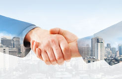 Handshake on a city background Stock Images