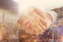 Handshake on city Royalty Free Stock Image