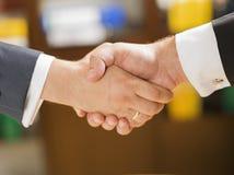 Handshake. Closeup of bussinesman shaking hands Stock Photos