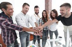 Handshake colleagues in creative Studio royalty free stock images