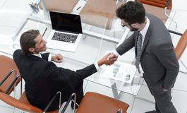 https://thumbs.dreamstime.com/t/handshake-colleagues-near-desktop-handshake-colleagues-near-desktop-office-120013211.jpg