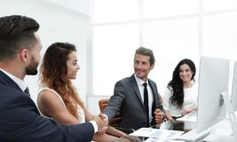 Handshake colleagues at a working meeting Royalty Free Stock Photos
