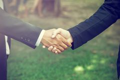Handshake. It is a collective agreement to work. In the garden. Royalty Free Stock Photos