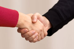 Handshake between common people Royalty Free Stock Images