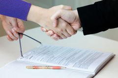 Handshake between common people Royalty Free Stock Photo
