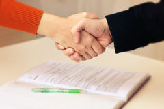 Handshake between common people Stock Photo
