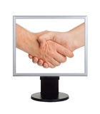 Handshake on computer screen Royalty Free Stock Images