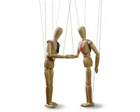 Handshake at the conclusion of the deal. Two puppets  shakes hands at the conclusion of the deal on white isolated backgroung Royalty Free Stock Photo