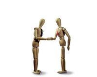 Handshake at the conclusion of the deal white, isolated. Two puppets  shakes hands at the conclusion of the deal on the white isolated background Royalty Free Stock Photography