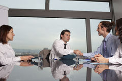 Handshake in conference room Stock Photography