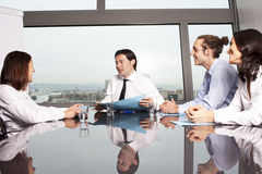 Handshake in conference room Stock Photos