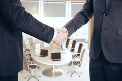Handshake in conference room Royalty Free Stock Images